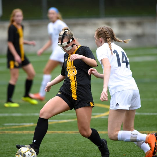 Red Lion's Gabby Young (23) evades the tackle during the girls soccer game between Red Lion and Dallastown, October 11, 2018. The Lady Lions beat the Wildcats 4-0.