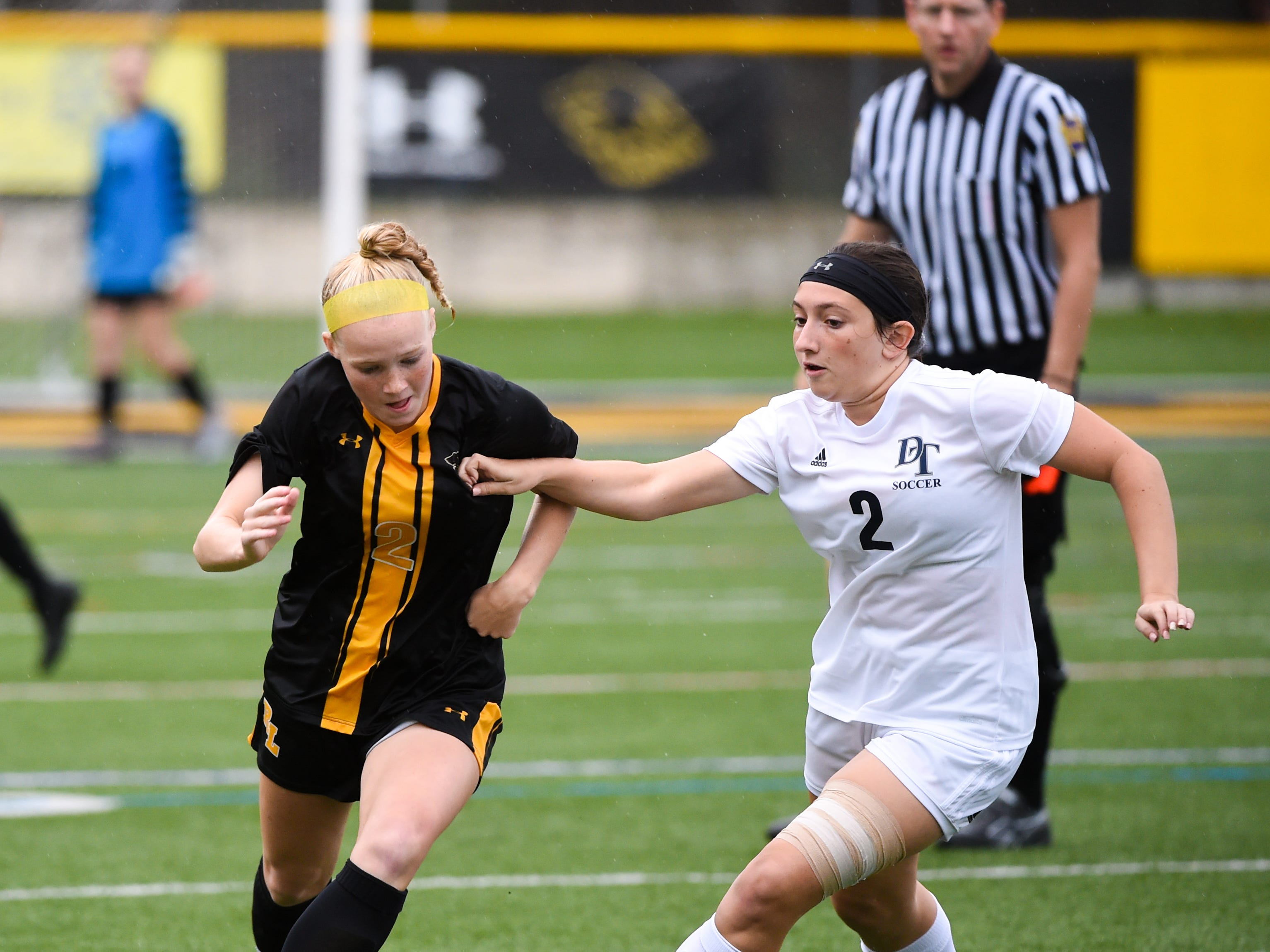 Red Lion's Natalie Sindlinger (2), left, looks to steal the ball from Dallastown's Megan Kelly (2), right, October 11, 2018. The Lady Lions beat the Wildcats 4-0.