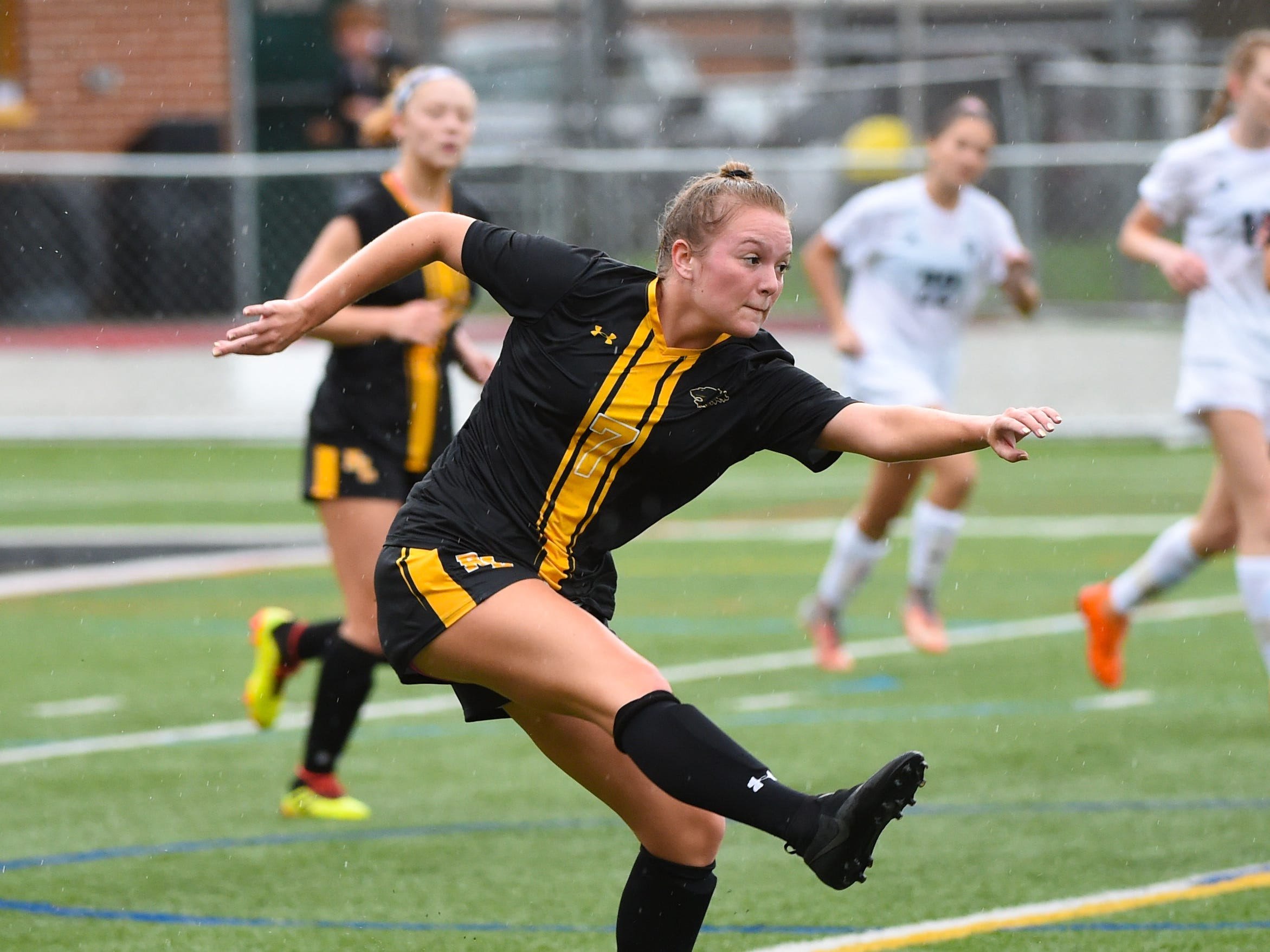 Red Lion's Lexis Kline (7) sends the ball downfield during the girls soccer game between Red Lion and Dallastown, October 11, 2018. The Lady Lions beat the Wildcats 4-0.