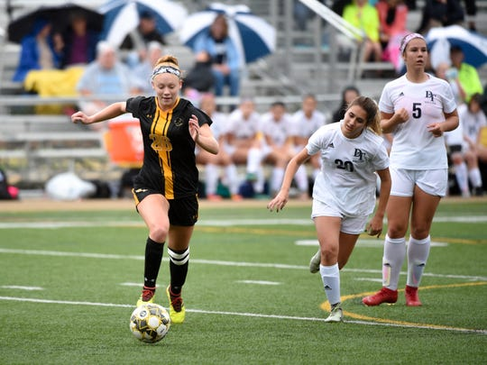 Paige Frey (26) of Red Lion outruns the defense during the girls soccer game, October 11, 2018. The Lady Lions beat the Wildcats 4-0.