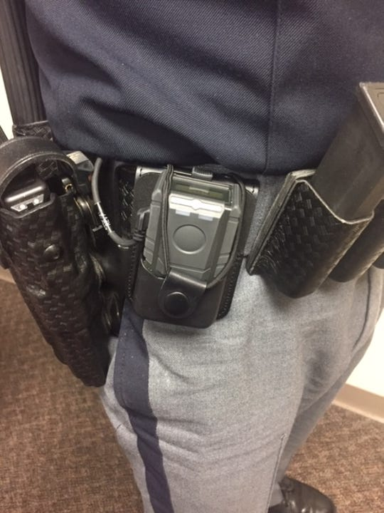 Sgt. Wilbur shows the newly released body cams.
