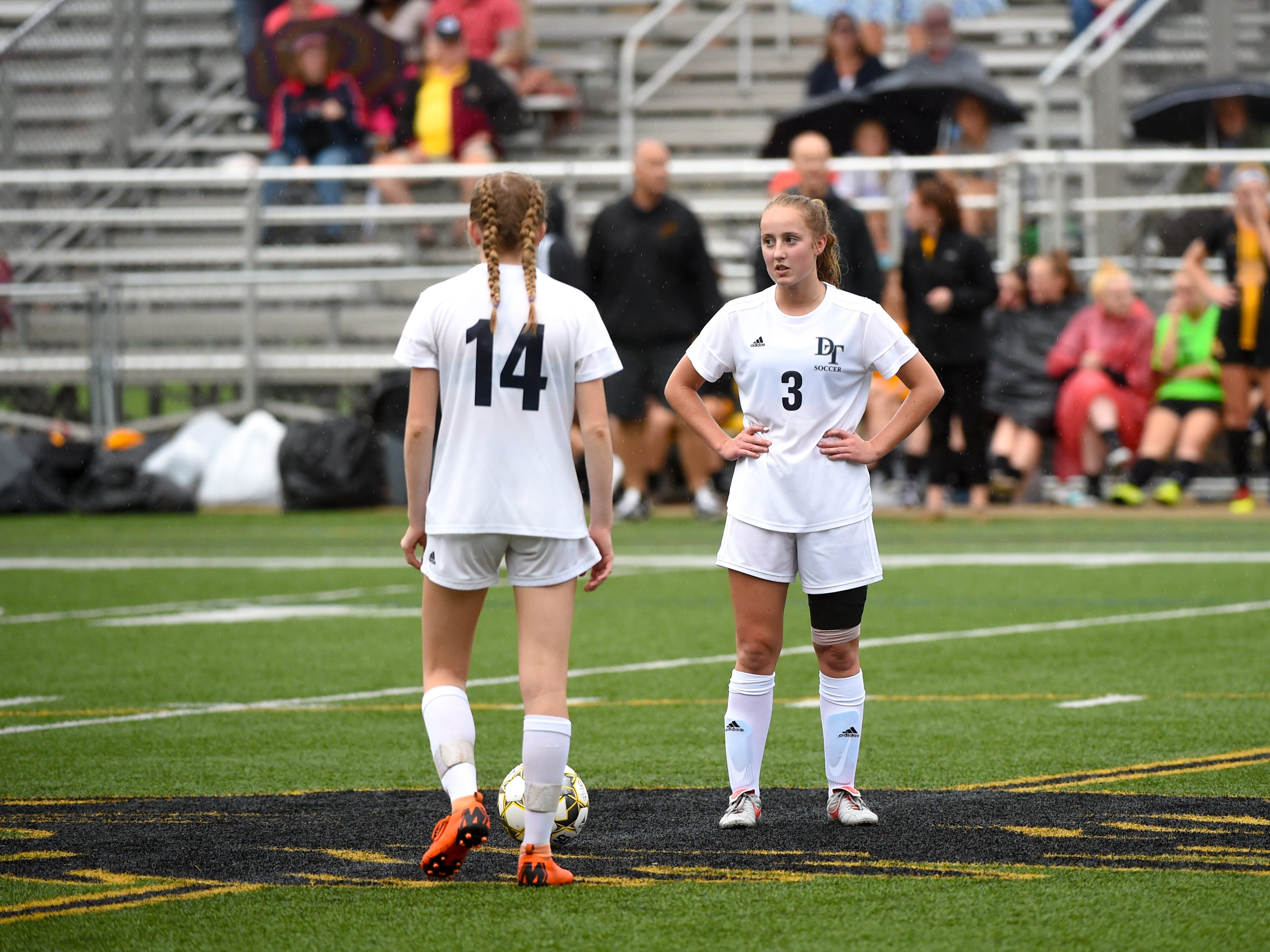 Dallastown's Ashley Robinson (14) and Caoline Muth (3) get ready to kick the ball off during the girls soccer game between Red Lion and Dallastown, October 11, 2018. The Lady Lions beat the Wildcats 4-0.