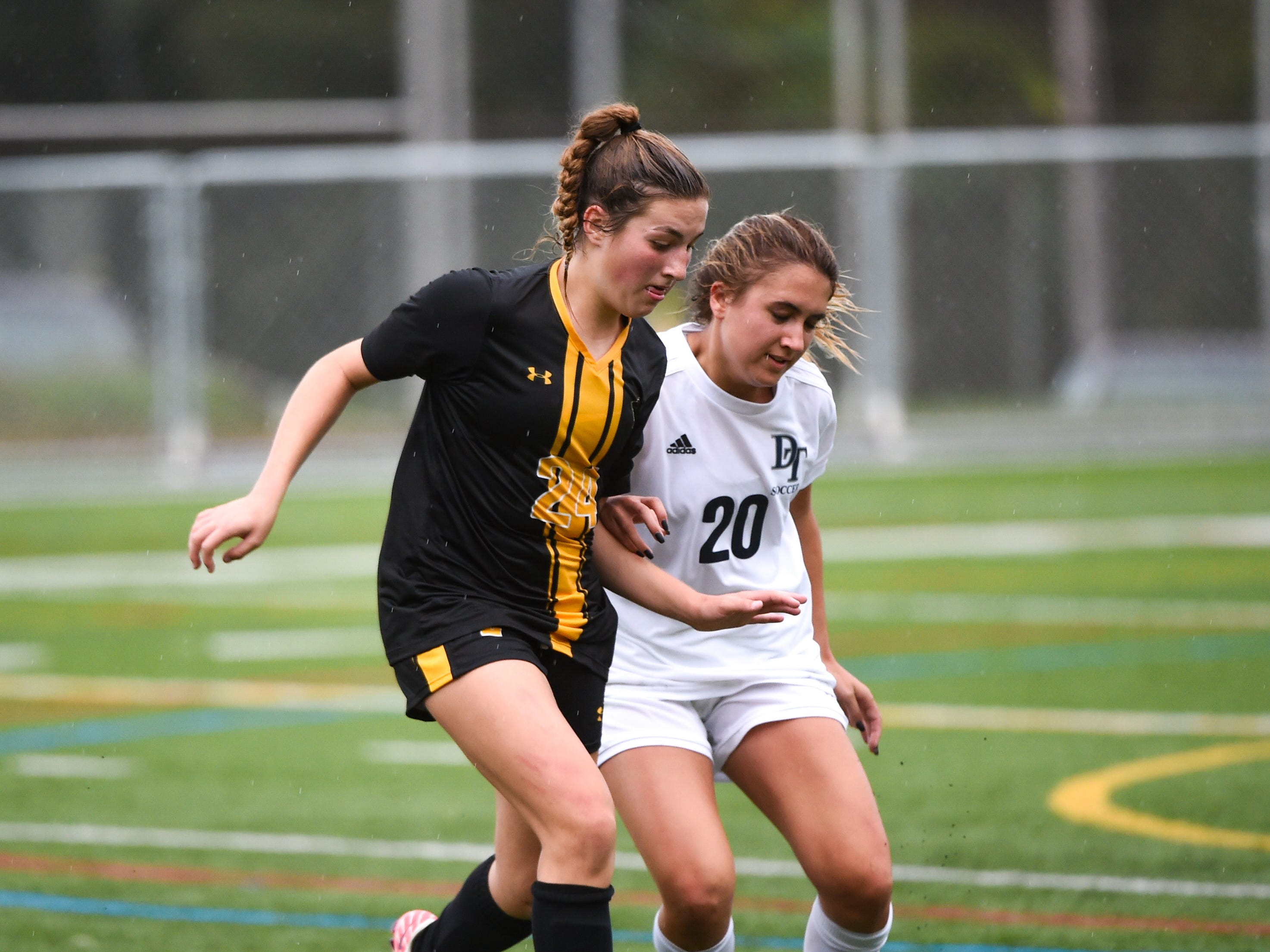 Delaney Bittner (24), left, and Jordan Lese (20), right, fight for possession during the girls soccer game between Red Lion and Dallastown, October 11, 2018. The Lady Lions beat the Wildcats 4-0.