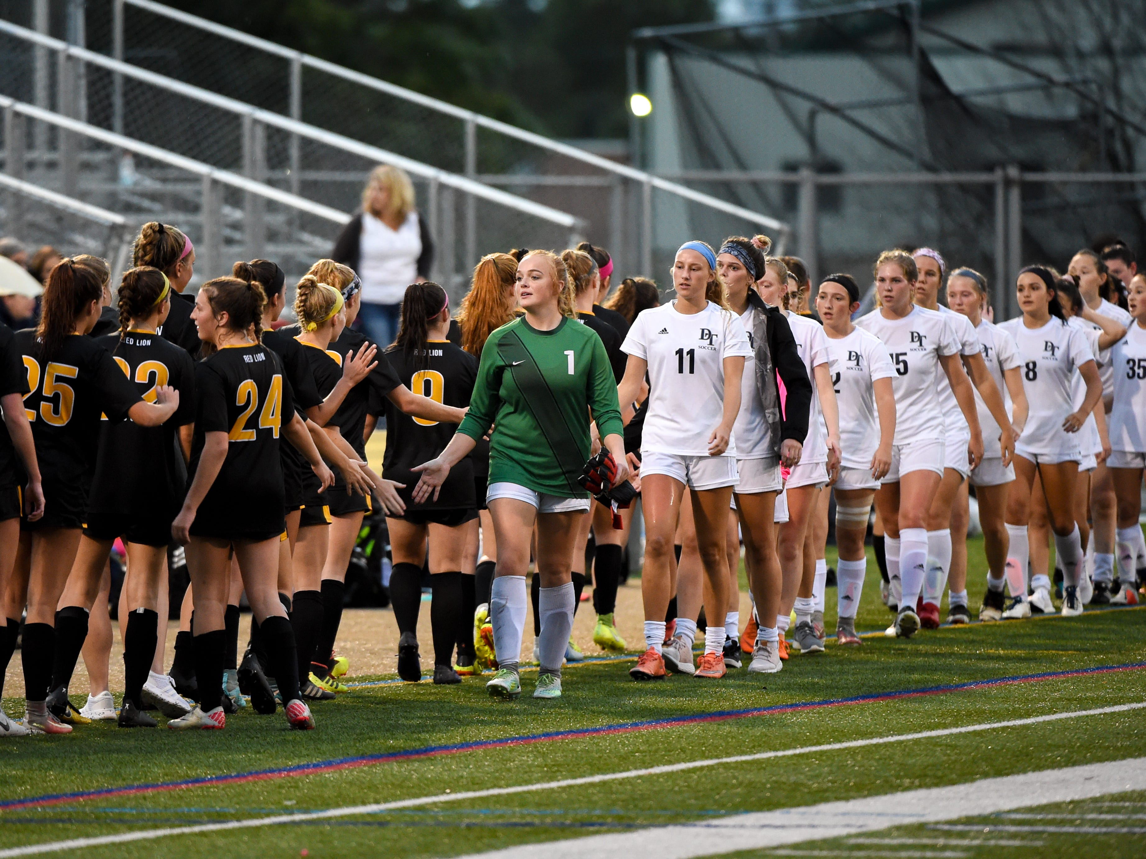 Dallastown and Red Lion players shake hands after a tough game, October 11, 2018. The Lady Lions beat the Wildcats 4-0.