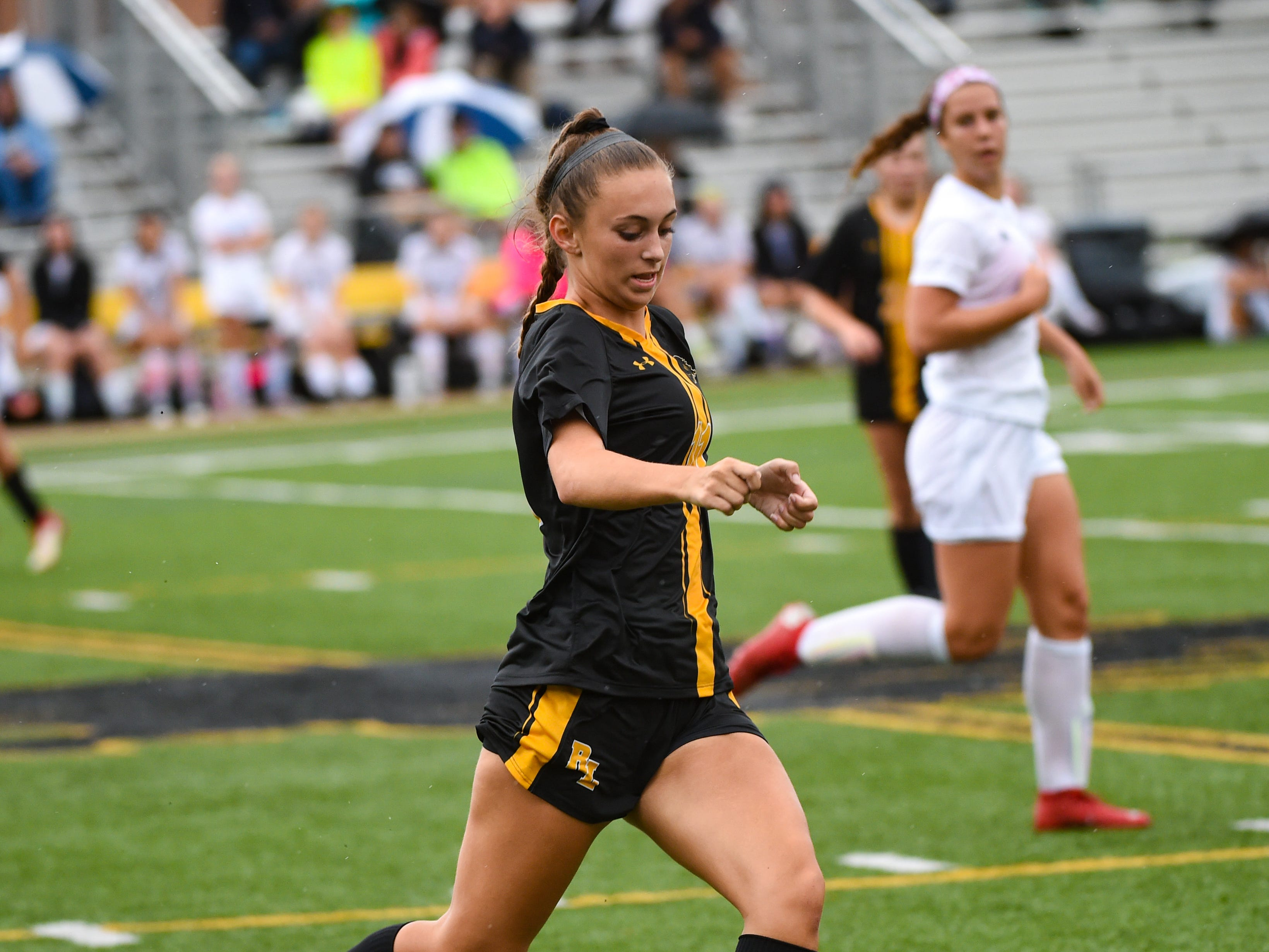 Red Lion's Caroline Frey (11) runs the ball up the sideline during the girls soccer game between Red Lion and Dallastown, October 11, 2018. The Lady Lions beat the Wildcats 4-0.