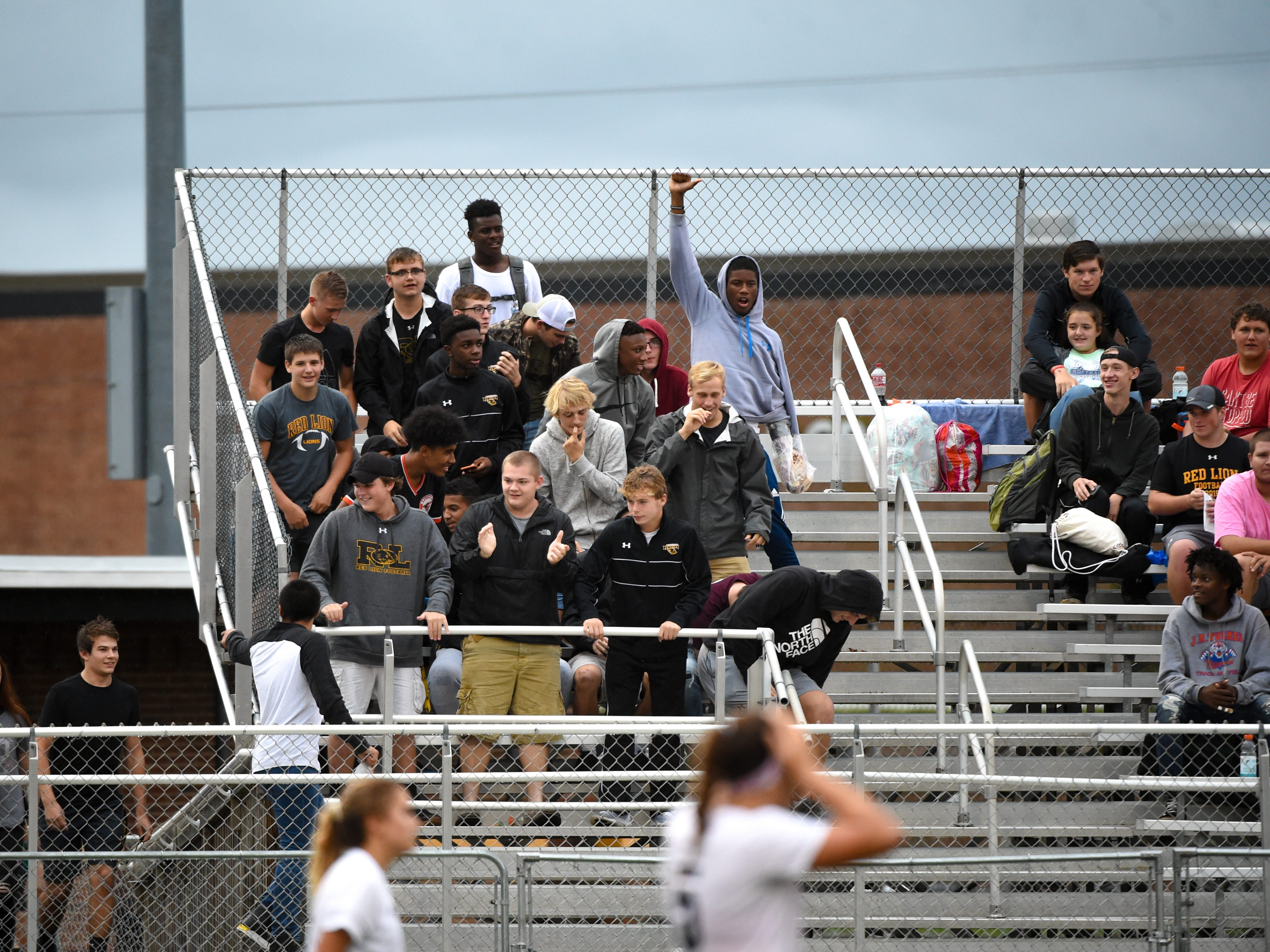 The Red Lion boys soccer team cheer on the girls during the girls soccer game between Red Lion and Dallastown, October 11, 2018. The Lady Lions beat the Wildcats 4-0.