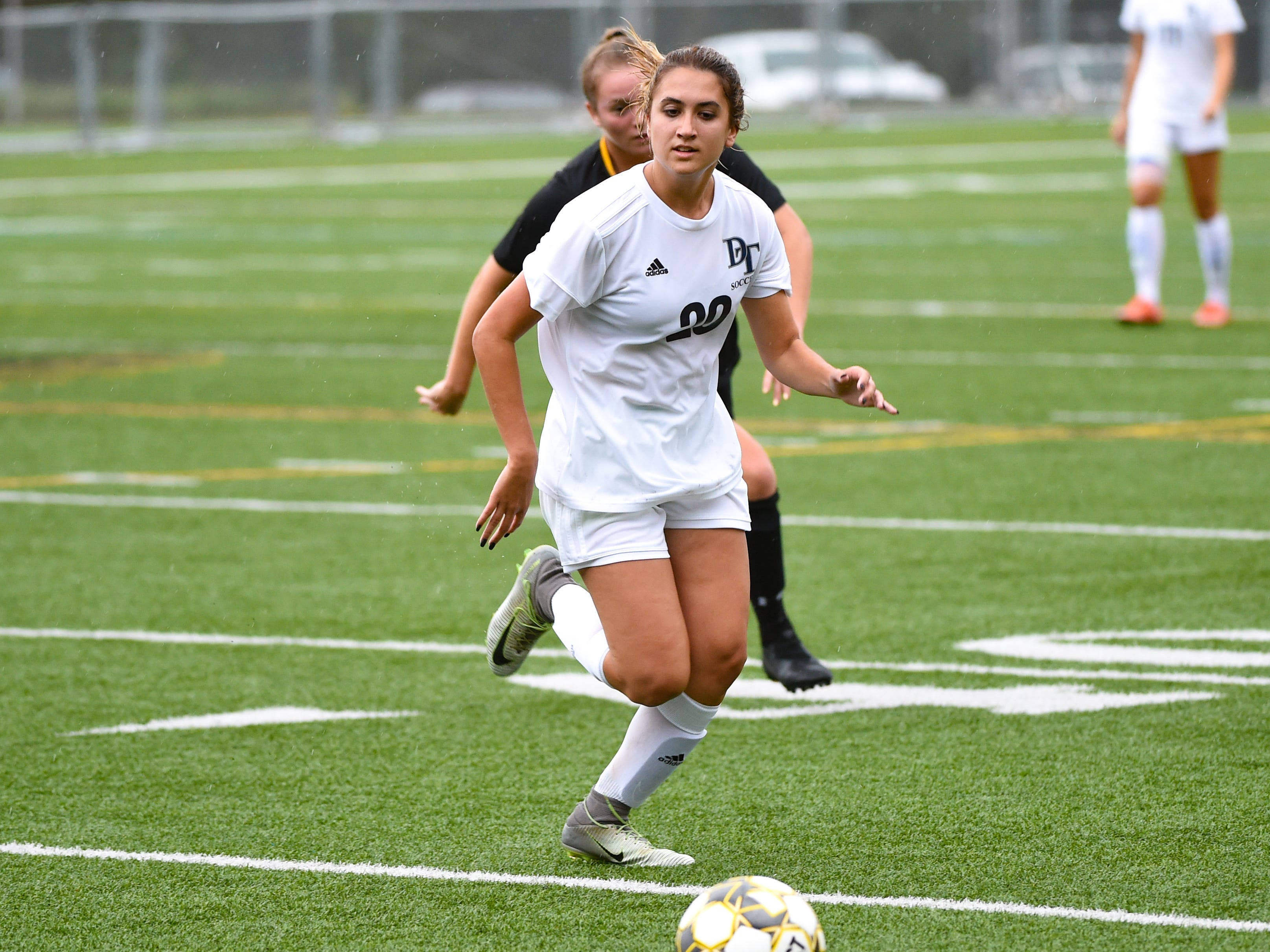 Dallastown's Jordan Lese (20) looks to stop the ball from going out of bounds during the girls soccer game between Red Lion and Dallastown, October 11, 2018. The Lady Lions beat the Wildcats 4-0.