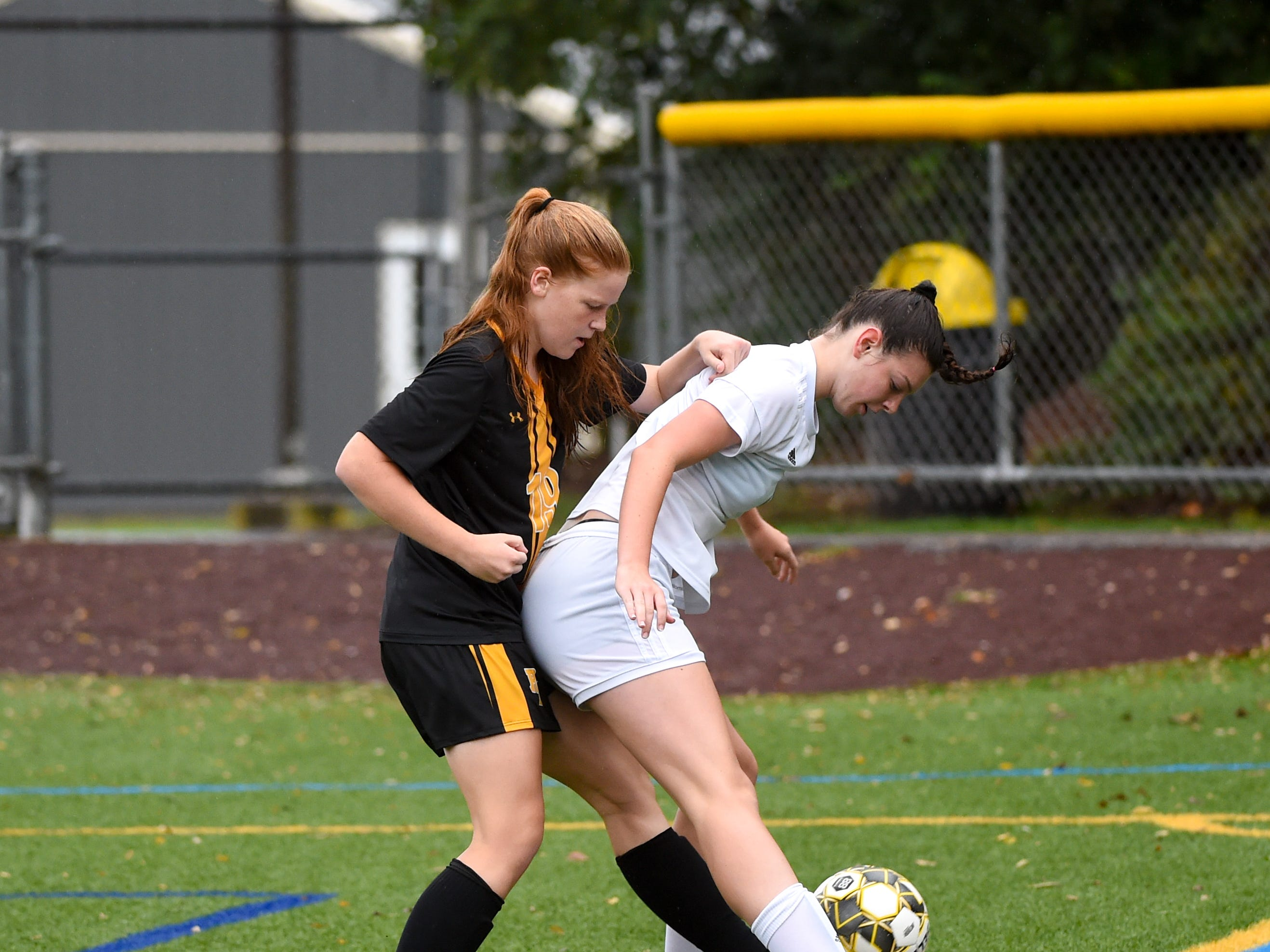 Red Lion's Anna Gatchell (19), left, tries to get around Dallastown's Skyler Wise (4), right, October 11, 2018. The Lady Lions beat the Wildcats 4-0.