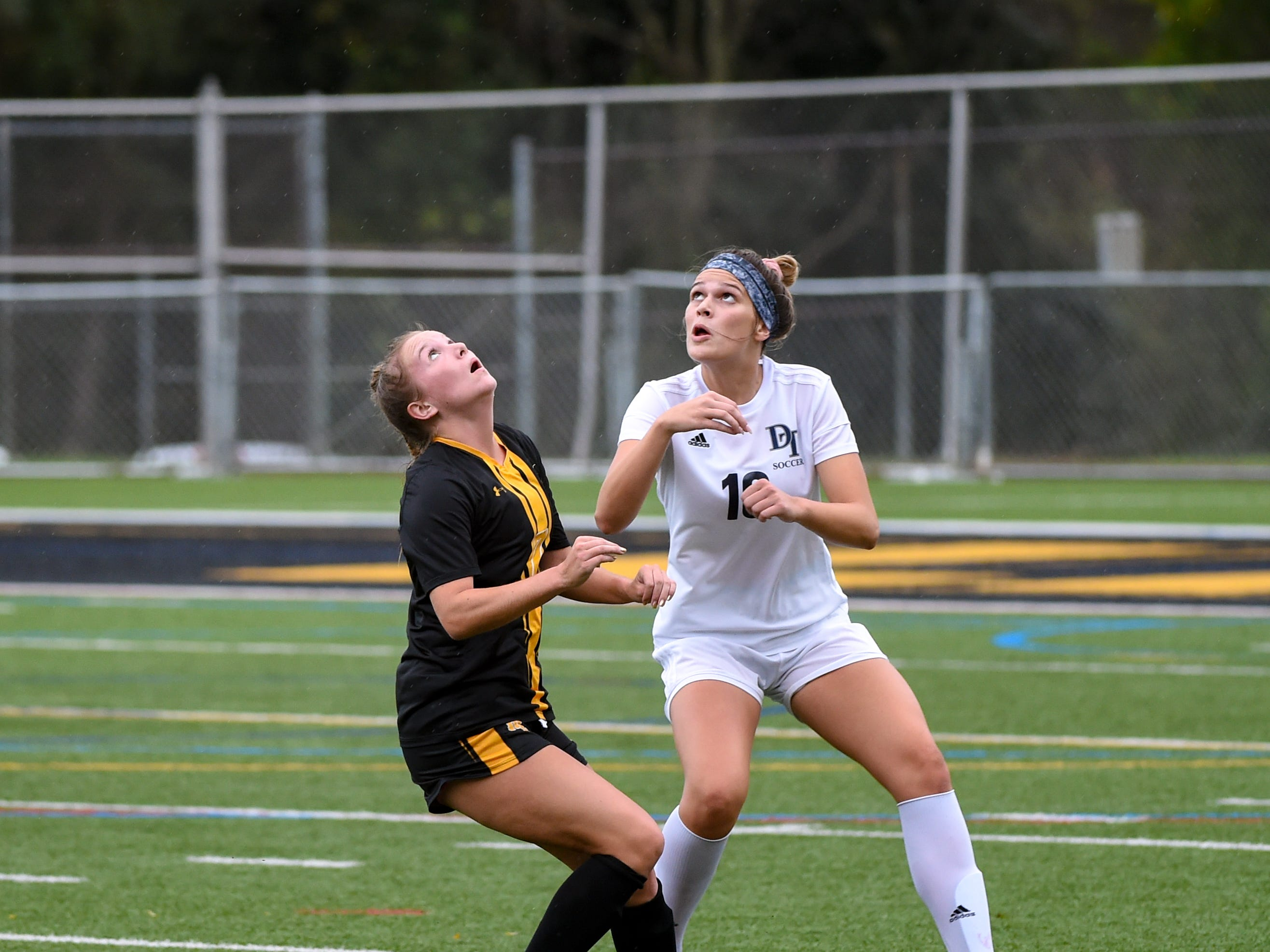 Dallastown's Brynn Darr (10), right, and Red Lion's Lexis Kline (7), left, look to win the header, October 11, 2018. The Lady Lions beat the Wildcats 4-0.