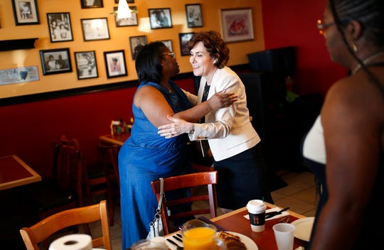 In this Sept. 29, 2018, photo, Rep. Jacky Rosen, D-Nev., right, embraces Carmen West during a breakfast event at TC's Rib Crib as she campaigns in Las Vegas.