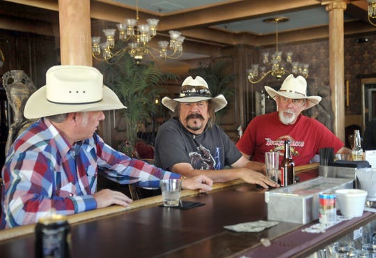 In this 2012 file photo, George Kahabka, right, enjoys a drink at the Mizpah Hotel's bar with friends Mitch Giberson, left, and David John of Comstock Cowboys fame.