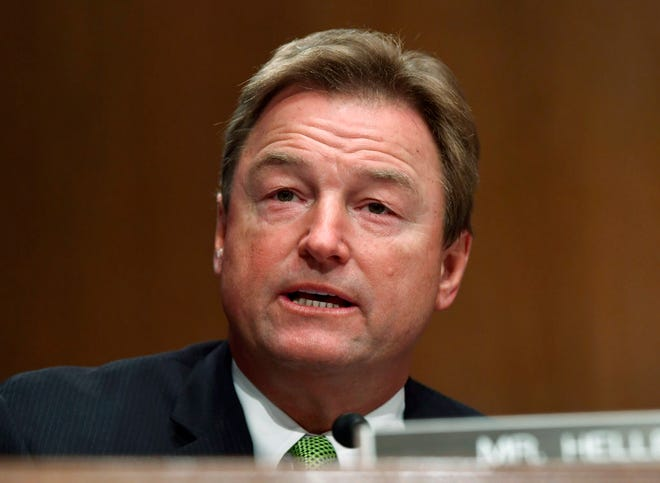 In this Jan. 30, 2018 file photo, Sen. Dean Heller, R-Nev., speaks during a Senate Banking Committee hearing on Capitol Hill in Washington.