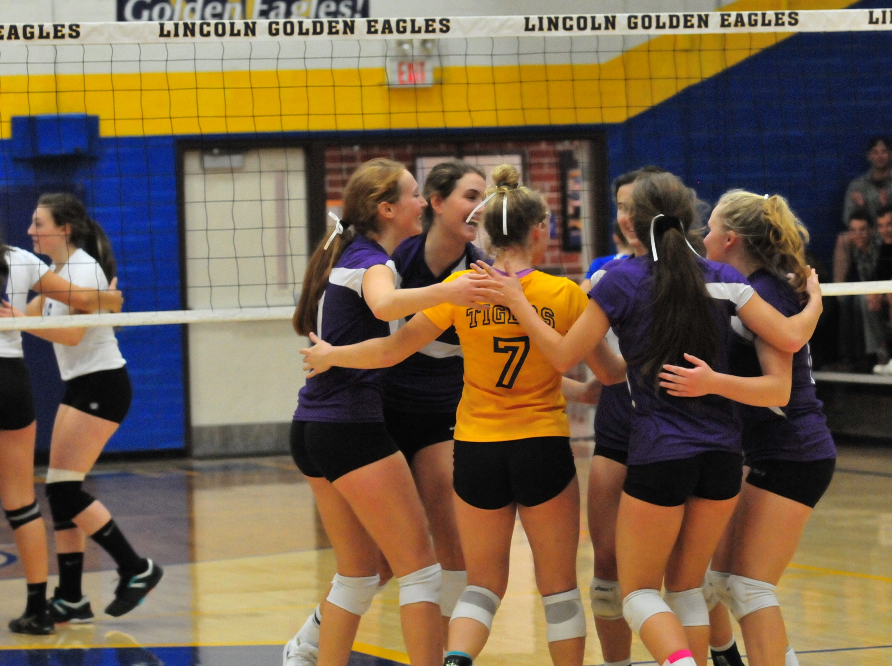 The Hagerstown volleyball team celebrates a point during a 3-0 win over Centerville Thursday, Oct. 11, 2018.