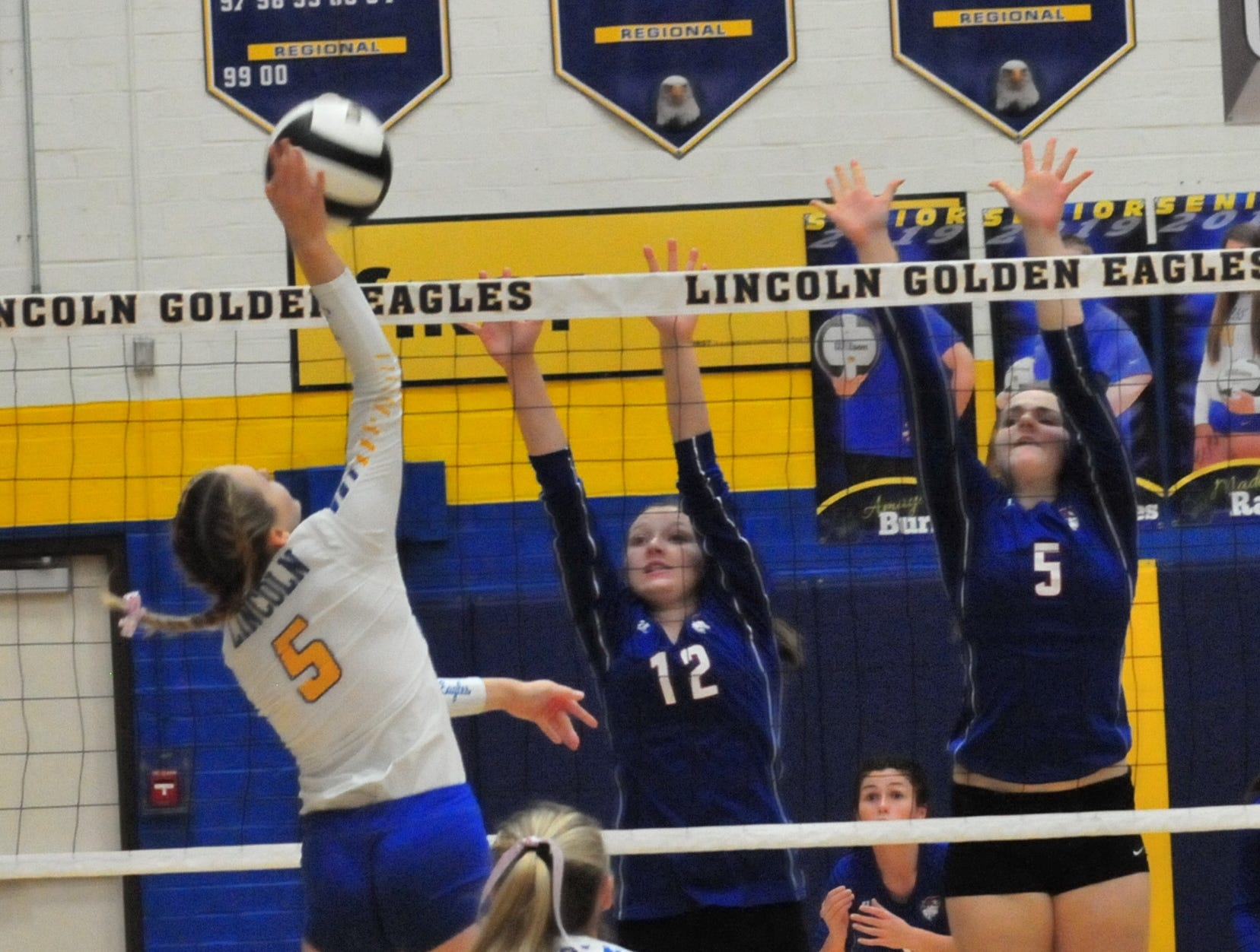 Lincoln's A;yssa Vickers (5) hits the ball during a 3-1 win over Union County Thursday, Oct. 11, 2018.