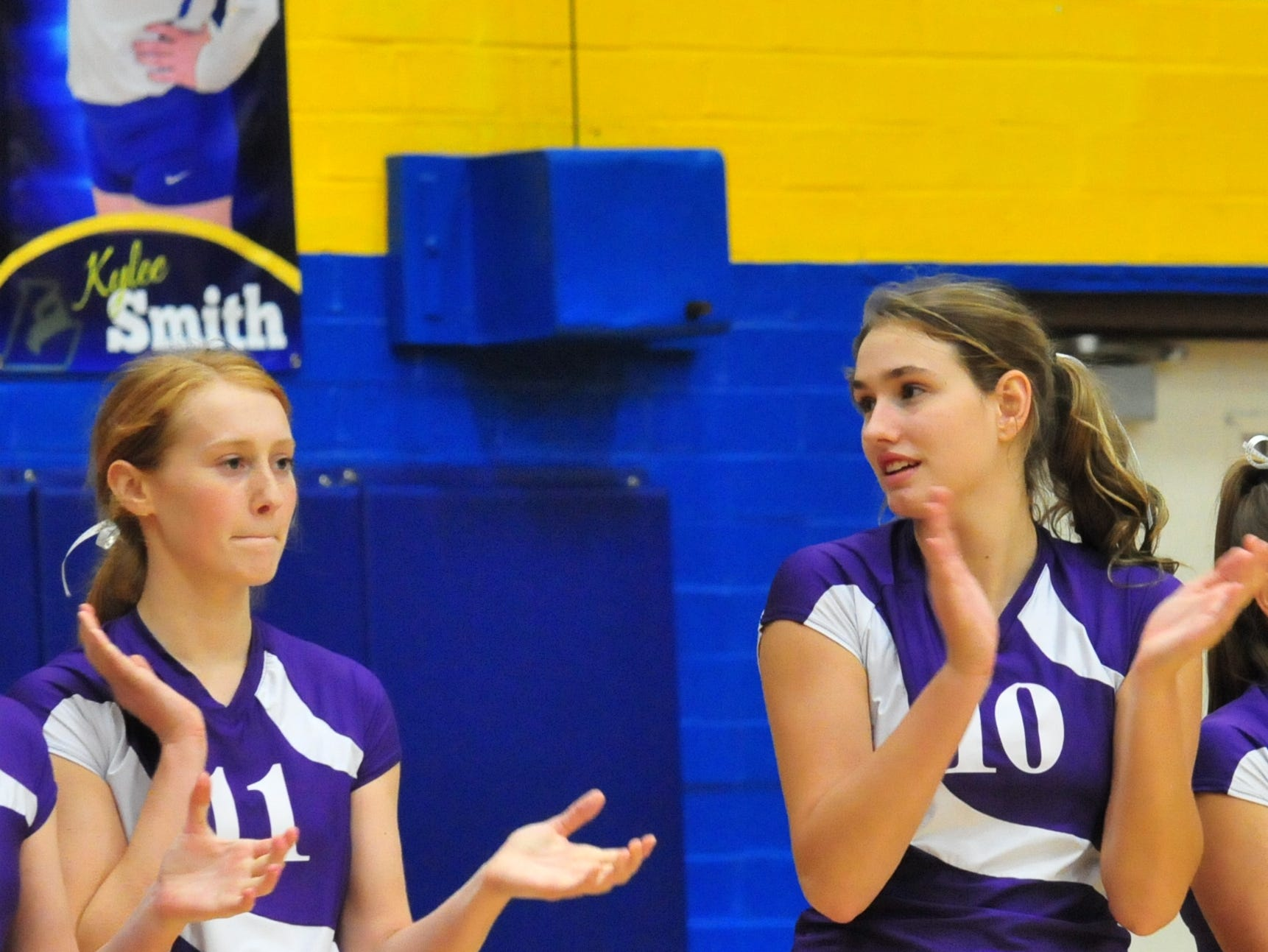 Jessica Swimm (11) and Regan Tinkle (10) of the Hagerstown volleyball team during a 3-0 win over Centerville Thursday, Oct. 11, 2018.