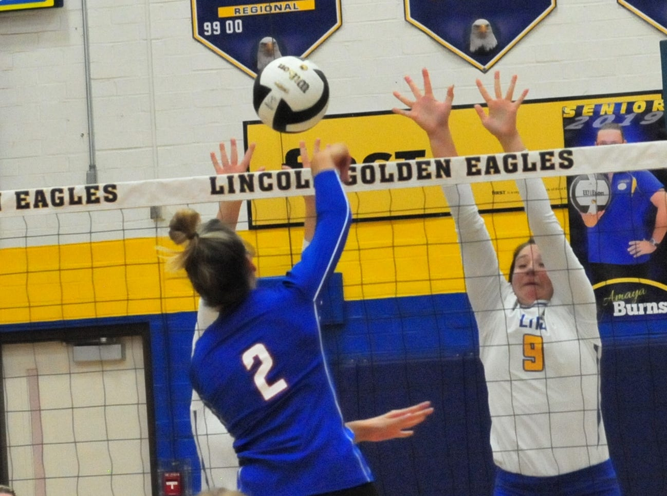 Lincoln's Laynie Russell (9) blocks a shot by Union County's Olivia Schwab (2) during Lincoln's 3-1 win over Union County Thursday, Oct. 11, 2018.