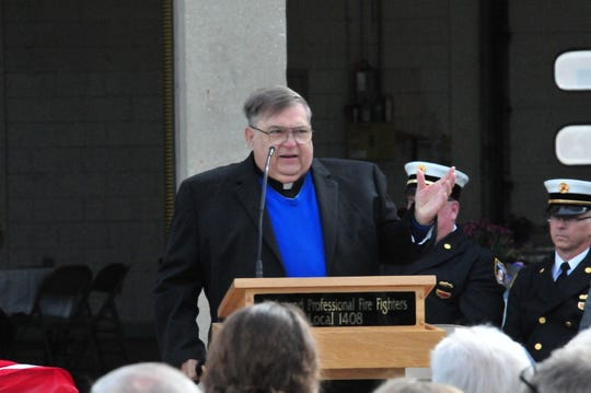 Father Kevin Morris offers a memorial message Friday during Richmond Fire Department's 48th annual Memorial Service.