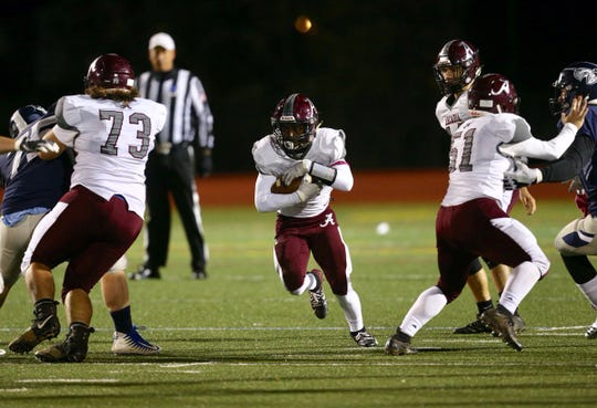 Greece Arcadia's offense moves down the field against Eastridge on Friday night.