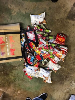 Officers say a 19-year-old stole these snacks from a youth-soccer facility and tagged its walls in the process.