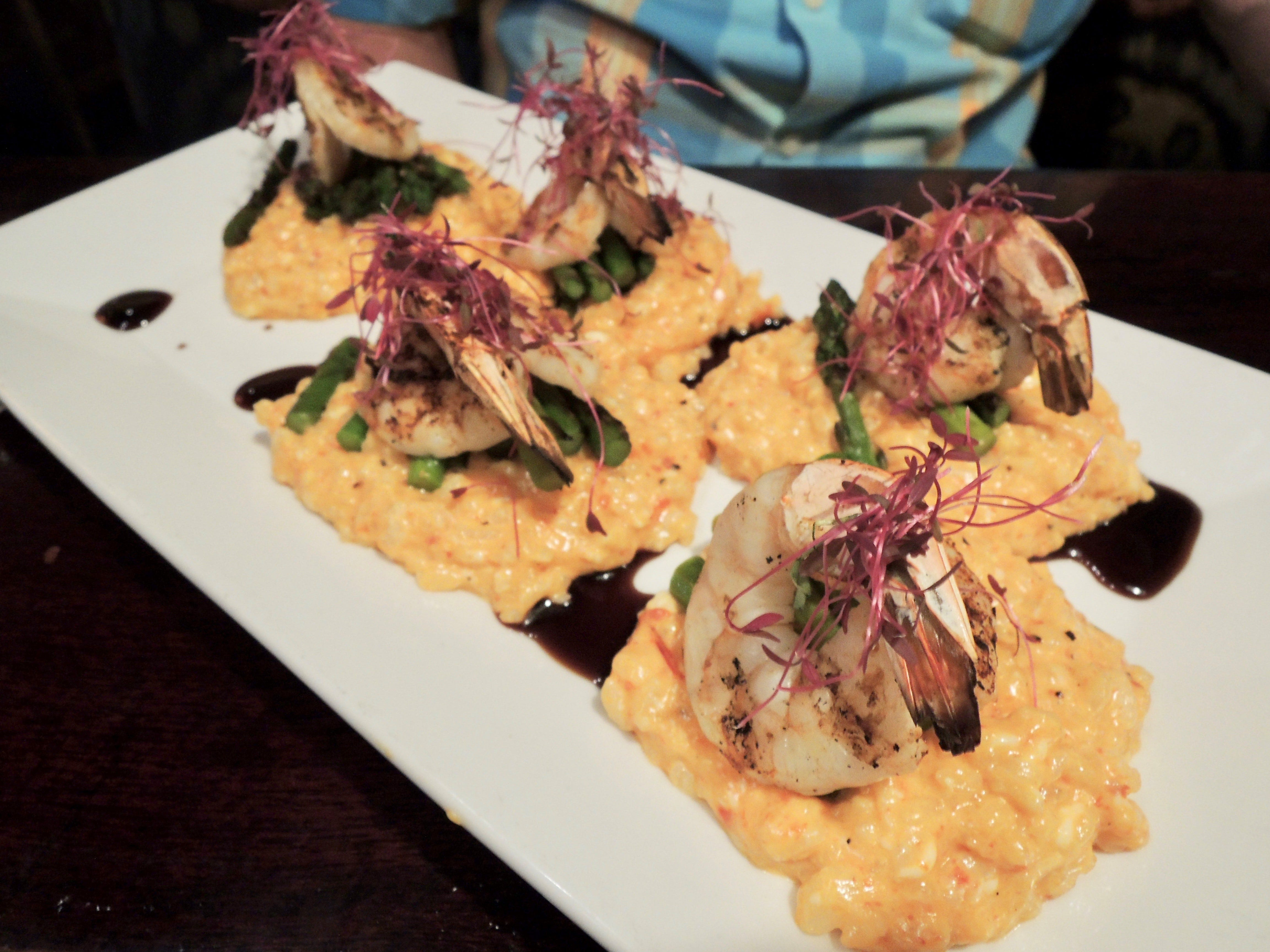 A special at Cicada Cantina--shrimp with red pepper risotto and asparagus and micro greens