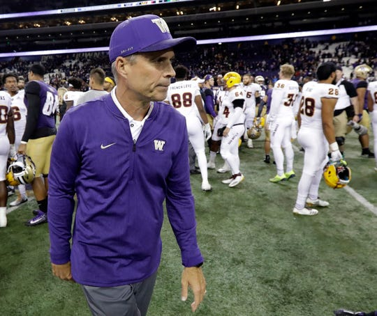 In this Saturday, Sept. 22, 2018, file photo, Washington head coach Chris Petersen walks off the field following an NCAA college football game against Arizona State in Seattle. If the Pac-12 wants to maximize its already damaged hopes of playing for a national championship No. 7 Washington needs to beat No. 17 Oregon on Saturday.