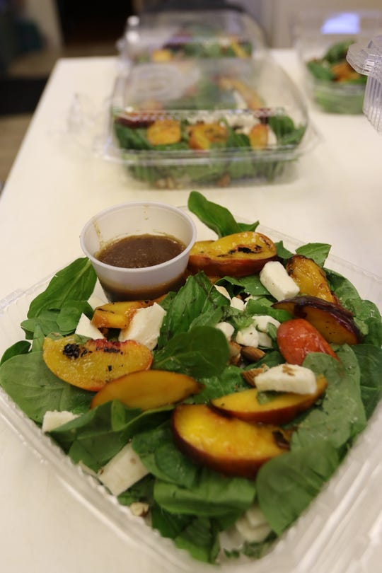 Grilled Peach Caprese Salad, one dish on the menu of Nourished Beginnings on July 31, 2018.