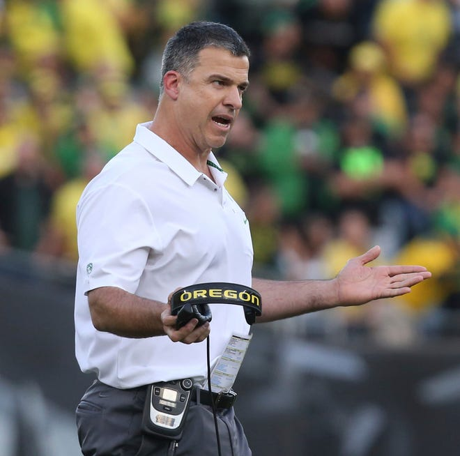 In this Saturday Sept. 22, 2018, file photo, Oregon coach Mario Cristobal gestures toward his team during the second half of an NCAA college football game against Stanford in Eugene, Ore. If the Pac-12 wants to maximize its already damaged hopes of playing for a national championship No. 7 Washington needs to beat No. 17 Oregon on Saturday.