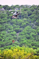 Debbie Thomas and her dog Chaps were airlifted from a tree Monday, Oct. 8, 2018, during flooding of the South Llano River in Junction, Texas.