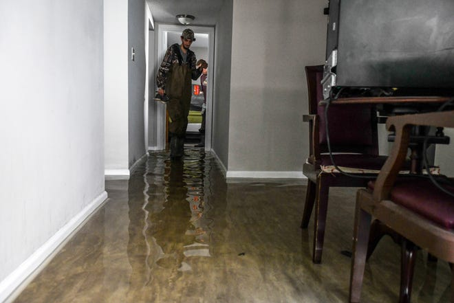 Ryan Clocker empties his flooded Canal Woods apartment on Friday, Oct 12, 2018 after Tropical Storm Michael passed through Salisbury overnight.