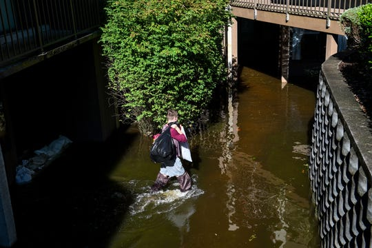 Canal Woods resident Zachery Taylor empties possessions from his flooded apartment on Friday, Oct 12, 2018 after Tropical Storm Michael passed through Salisbury overnight.