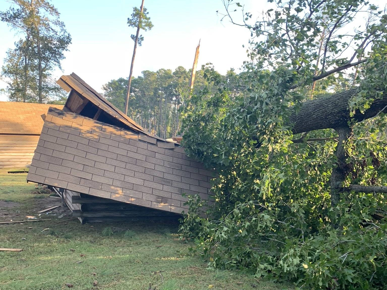 Strong winds from Tropical Storm Michael brought this tree down  on a structure at the Cherrystone Family Camping Resort in Cape Charles. The resort said in a facebook post it was under mandatory evacuation and will be closed under further notice.