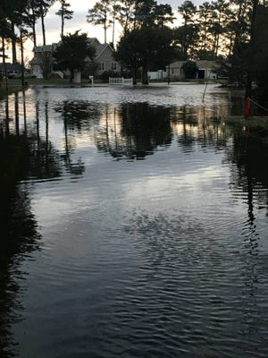 Flooding in East Point, near Onancock, Virginia, on Friday morning after Tropical Storm Michael swept through the region.