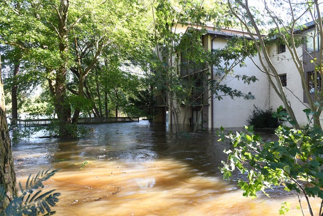 Waters flood the Canal Woods apartment complex in Salisbury, Maryland on Friday, Oct. 12, 2018.