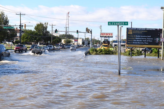 Water floods parts of Alexander Avenue on Friday, Oct. 12, 2018 in Salisbury, Maryland.