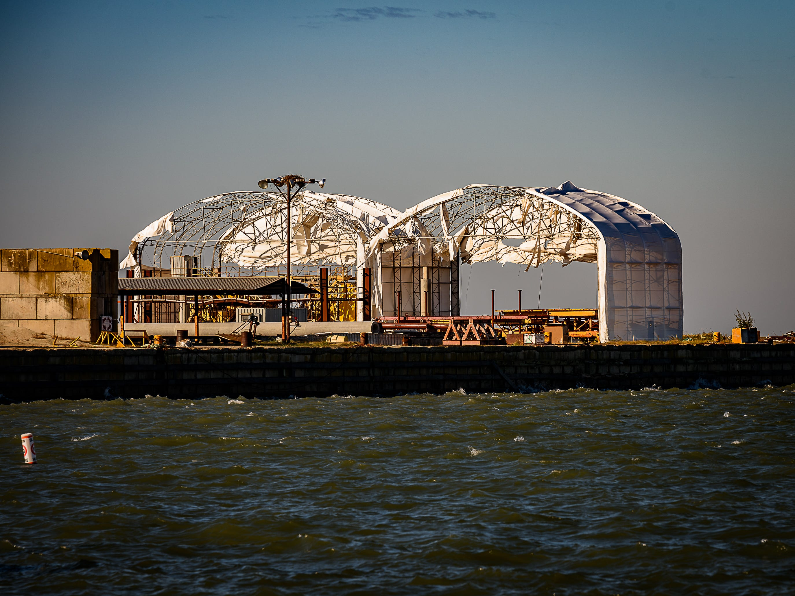 Buildings at the former Bayshore Concrete Plant had their plastic rooofs shredded during a recent storm in the Eastern Shore of Virginia.