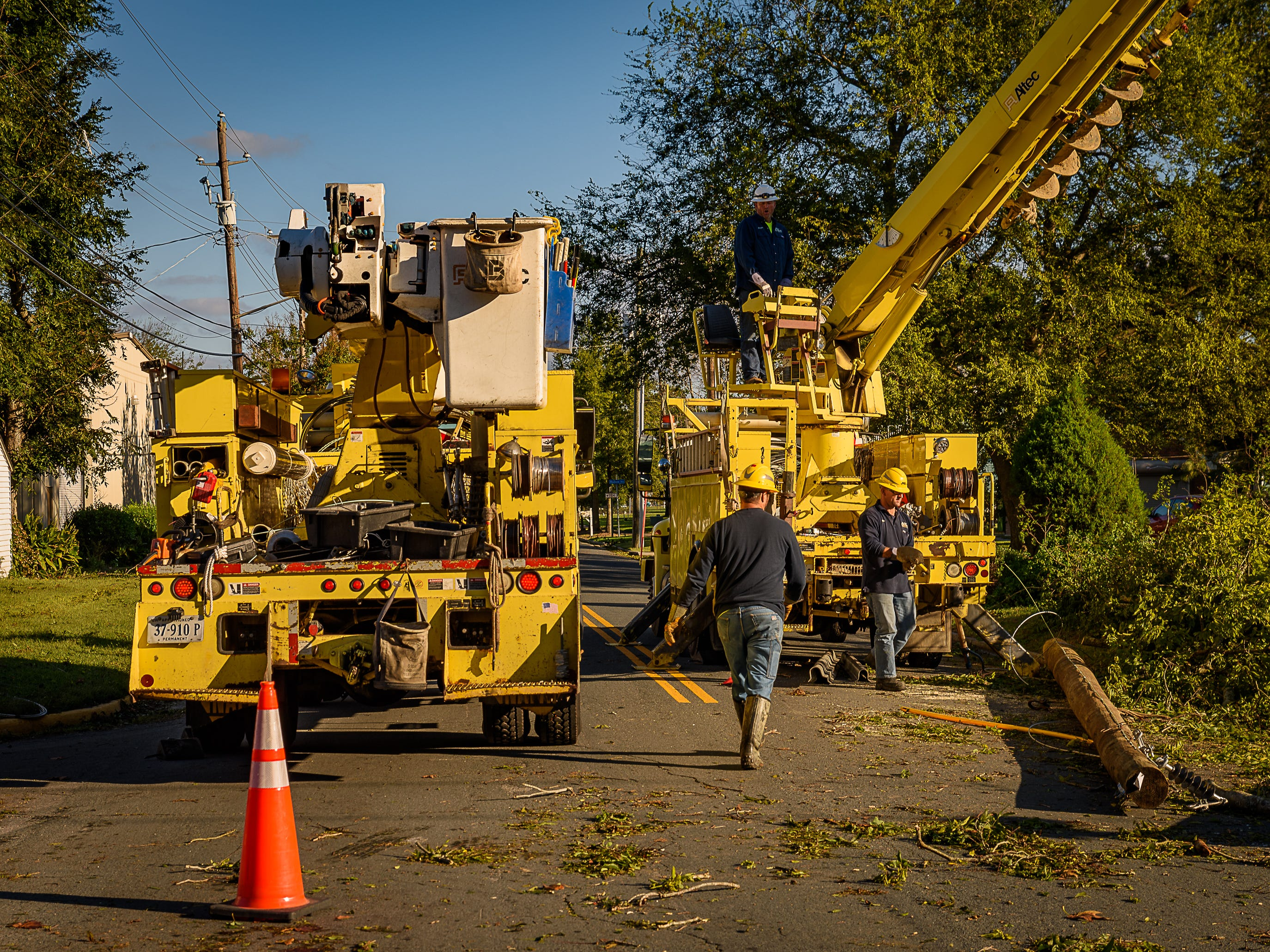 An ANEC crew works to replace a downed pole on Fig Street in Cape Charles, Virginia.
