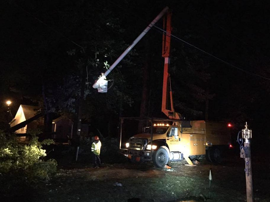 A tree service truck tackles a downed tree in Exmore, Virginia, as Tropical Storm Michael comes through the region Thursday night.