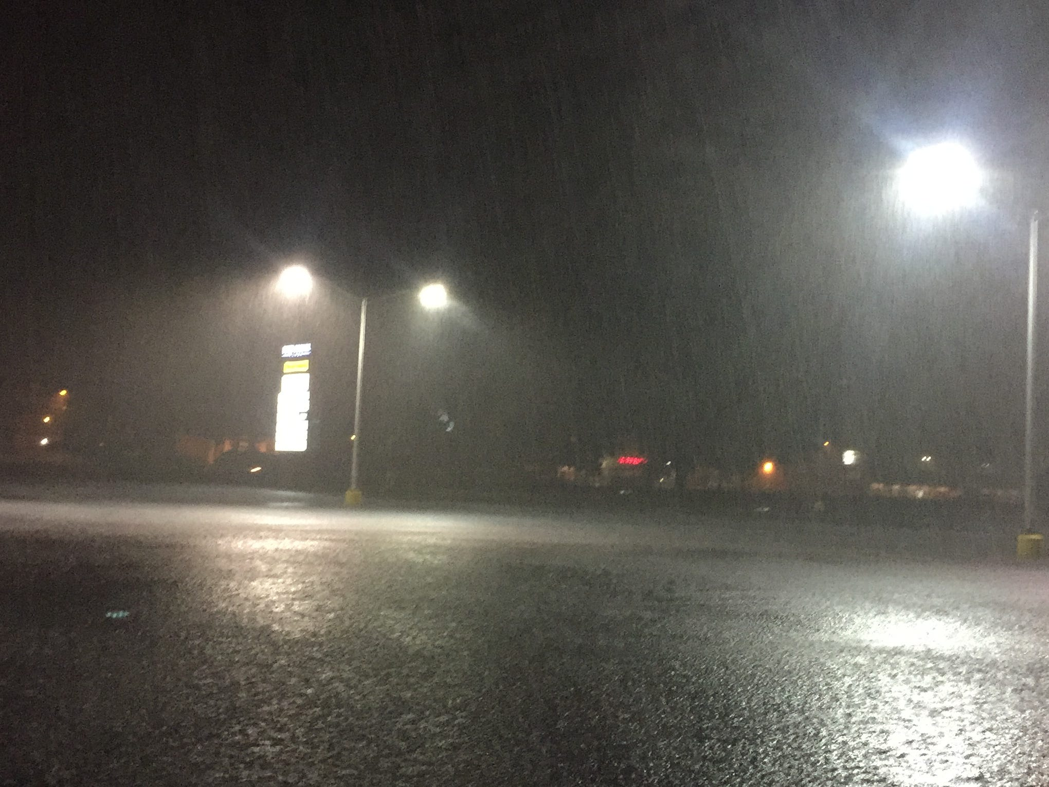 Heavy rain falls on  Four Corner Plaza in Onley, Virginia, as Delmarva begins to feel the effects of Tropical Storm Michael Thursday night, Oct. 11.