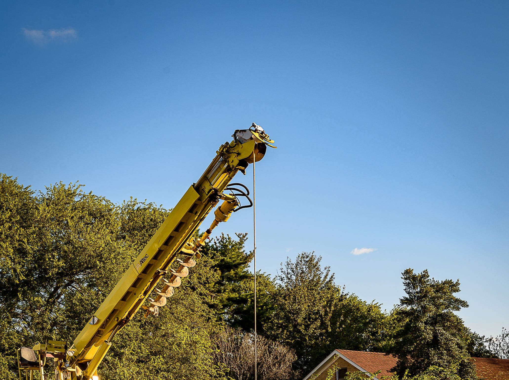An ANEC crew works to replace a downed pole on Fig Street in Cape Charles on Oct. 12, 2018.