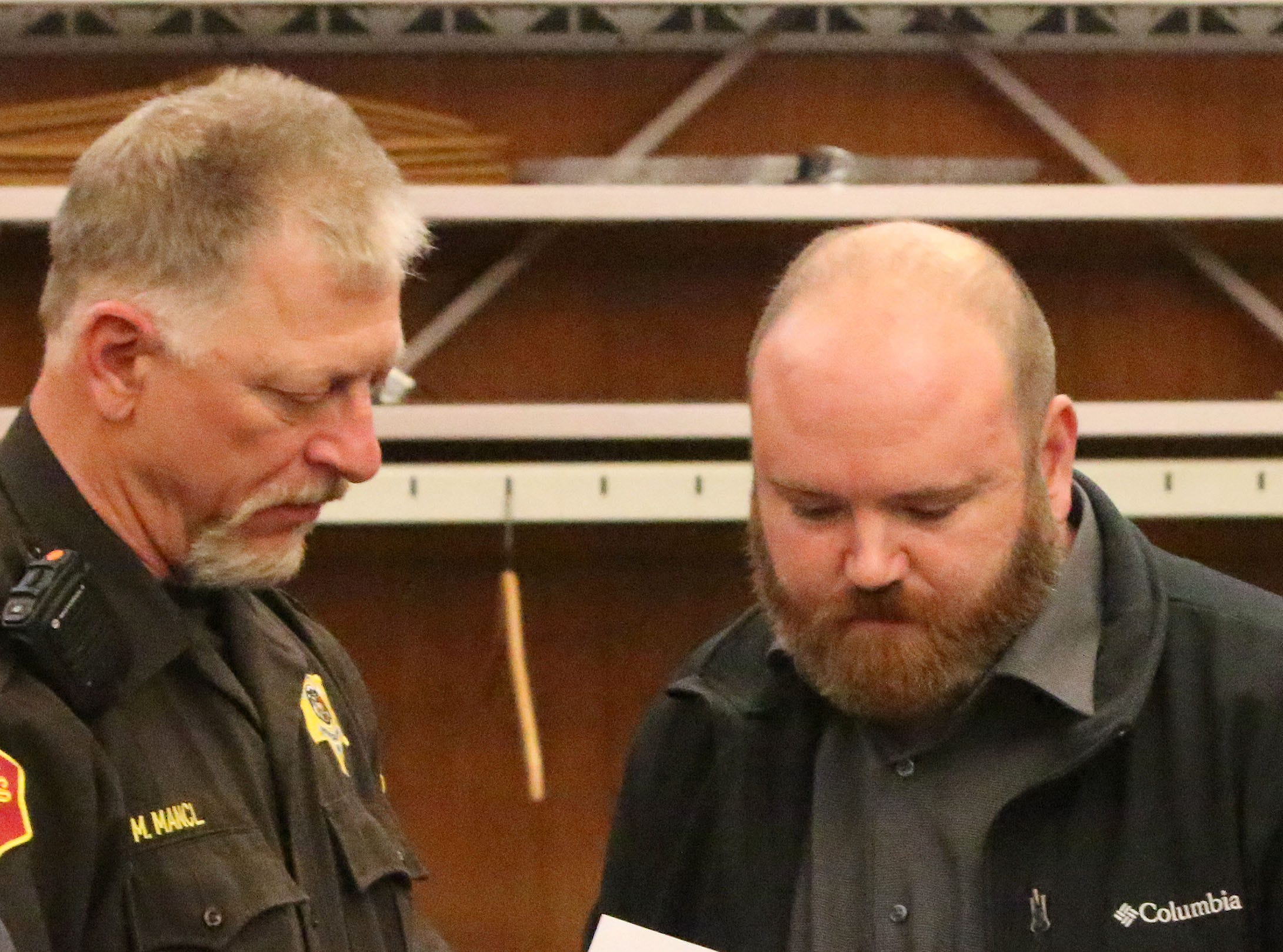 Sheboygan County Circuit Court Branch 1 bailiff Mark Mancl, left, explains instructions to Anthony James Keyport following his sentencing hearing, Friday, October 12, 2018, in Sheboygan, Wis. Keyport was given jail and probation.