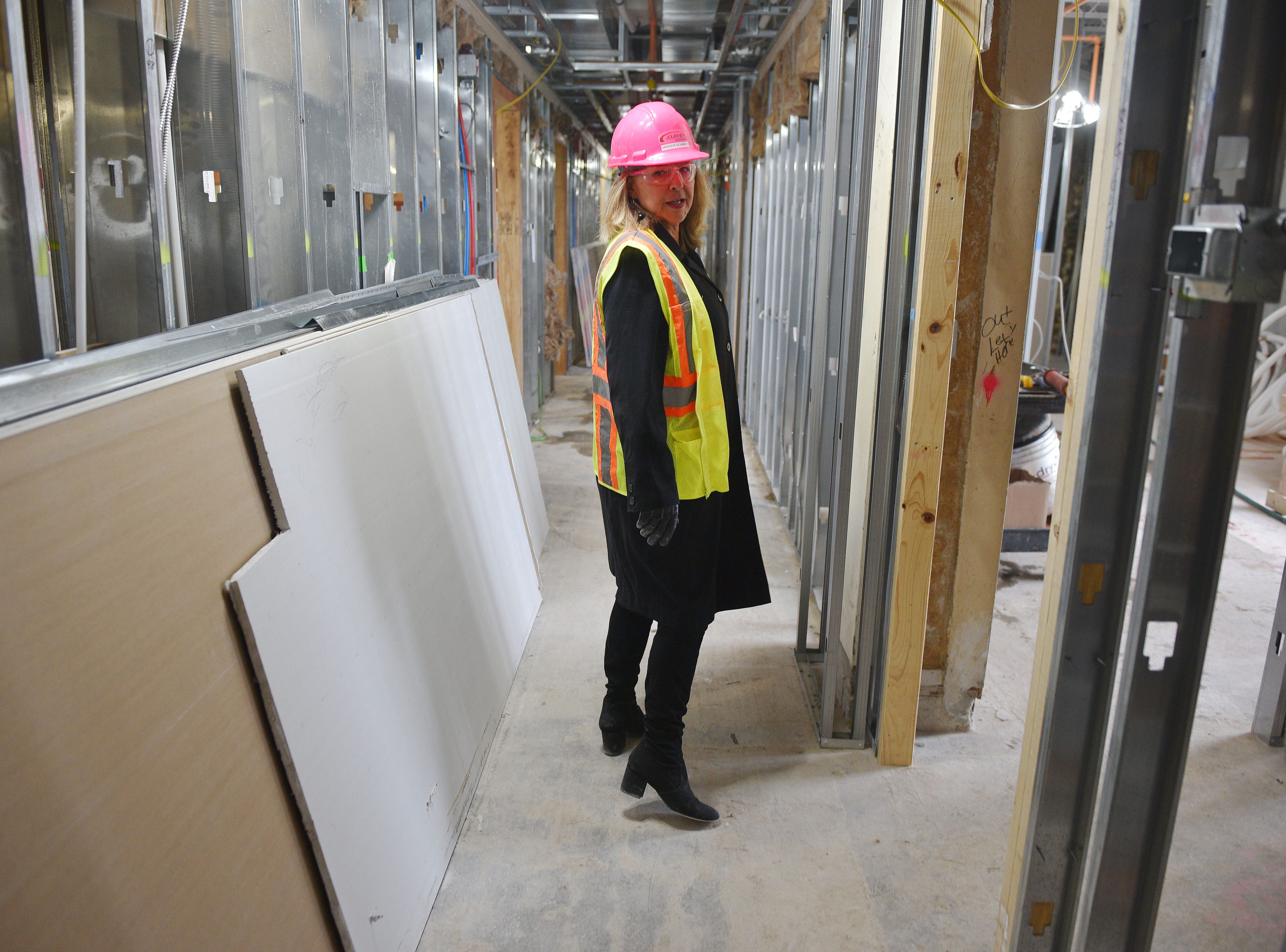 Kelly Inns President and CEO Brenda Schmidt gives a tour of Hotel Phillips during Thursday, Oct. 11, in downtown Sioux Falls. The luxury hotel is an ongoing remodel of the old Great Western building.
