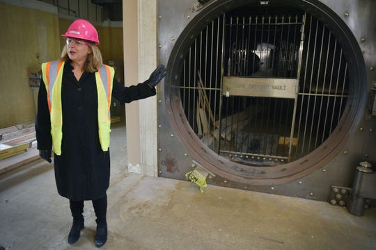 Kelly Inns President and CEO Brenda Schmidt talks about an original vault that is going to be a part of the design of Hotel Phillips during Thursday, Oct. 11, in downtown Sioux Falls. The luxury hotel is an ongoing remodel of the old Great Western building.