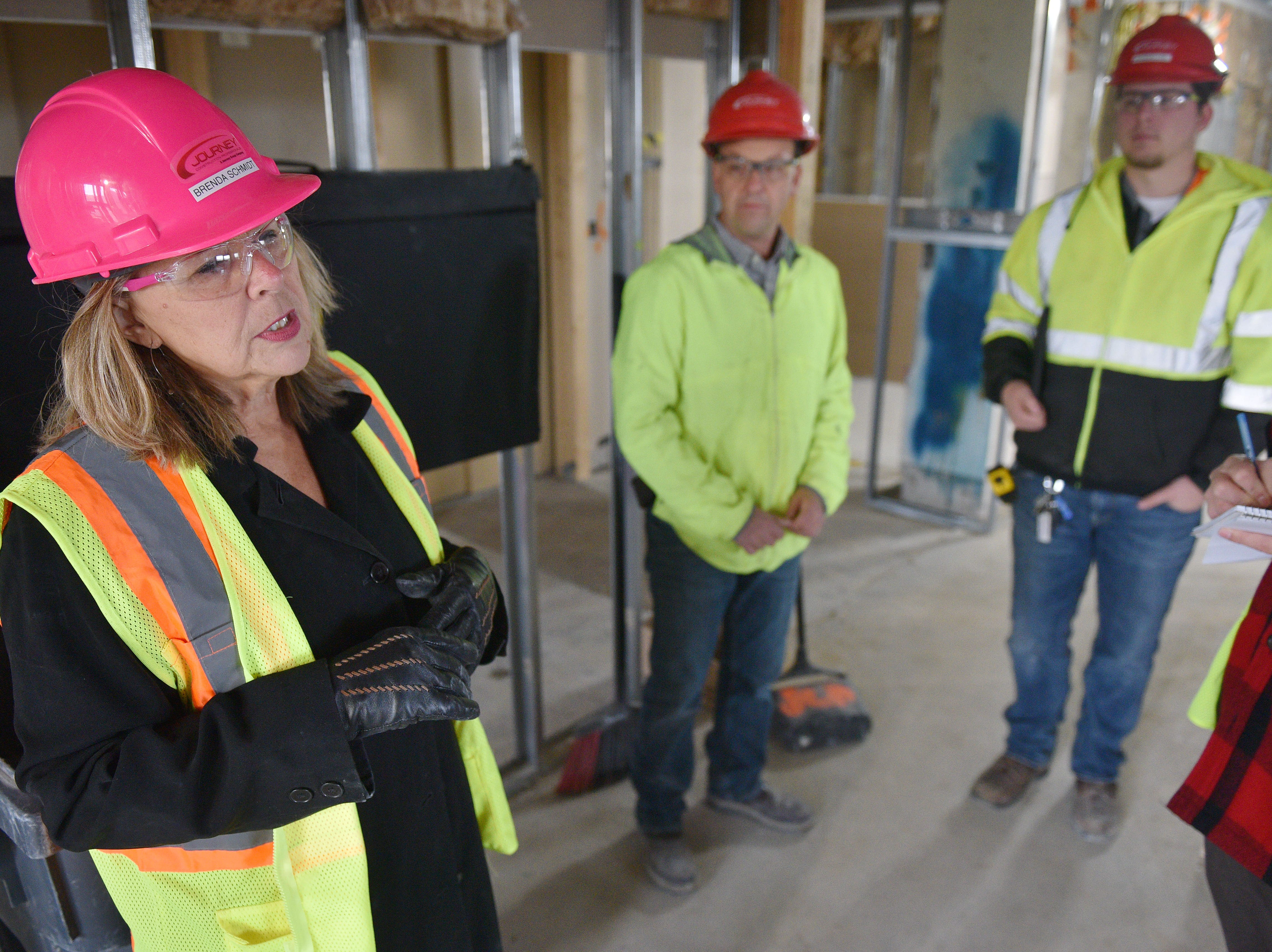 Kelly Inns President and CEO Brenda Schmidt, left, gives a tour of Hotel Phillips with Journey superintendent Roger Klebe, center, and project engineer Jacob Mulder, right, Thursday, Oct. 11, in downtown Sioux Falls. The luxury hotel is an ongoing remodel of the old Great Western building.