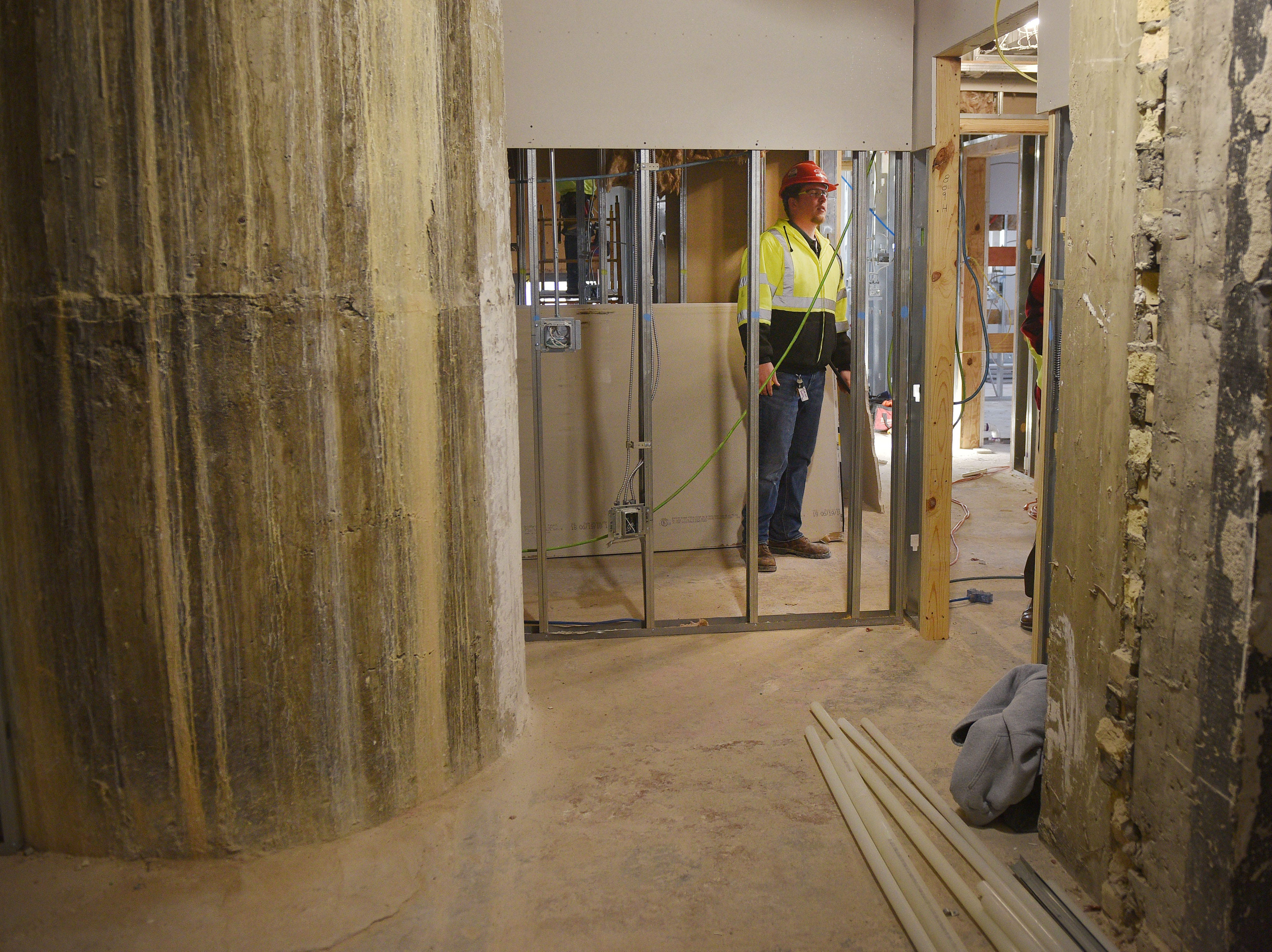 Journey project engineer Jacob Mulder walks through Hotel Phillips Thursday, Oct. 11, in downtown Sioux Falls. The luxury hotel is an ongoing remodel of the old Great Western building.