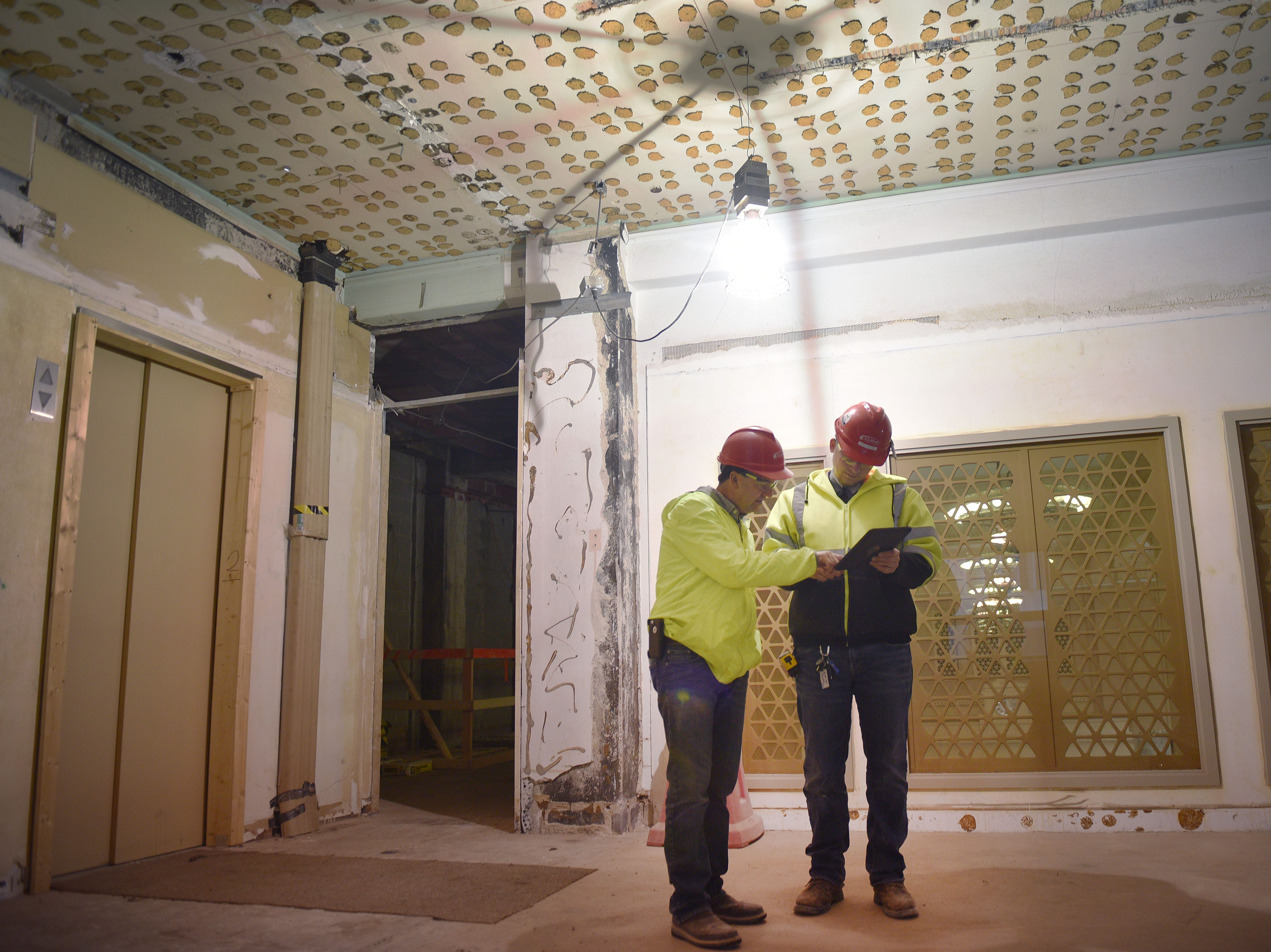 Journey superintendent Roger Klebe, left, and project engineer Jacob Mulder, right, walk through Hotel Phillips Thursday, Oct. 11, in downtown Sioux Falls. The luxury hotel is an ongoing remodel of the old Great Western building.