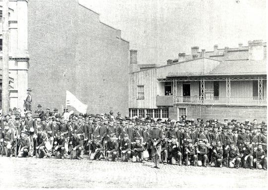 The West Augusta Guard poses at the C&O train station in Staunton in 1897, a year before it boarded trains bound for service in the Spanish-American War.