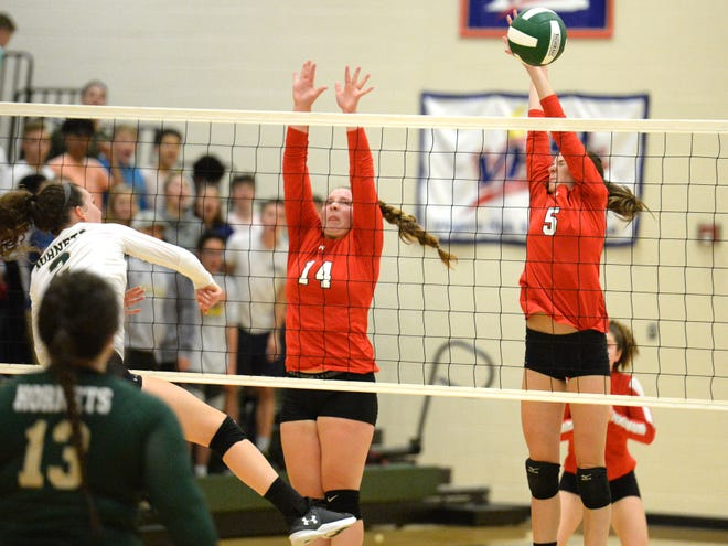 Riverheads' Dayton Moore (14) and Abbey Eavers (5) try to block an attack by Wilson Memorial's Cassidy Davis Thursday night in a Shenandoah District volleyball match in Fishersville.