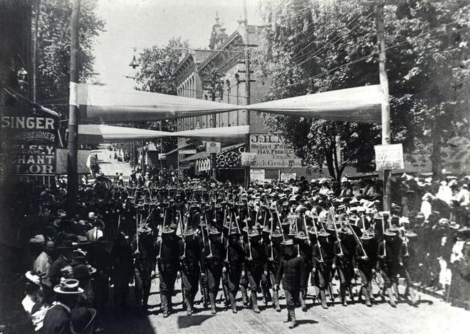 The Staunton Rifles, sporting Spanish-American War uniforms, march through downtown Staunton in this circa 1903 photograph.