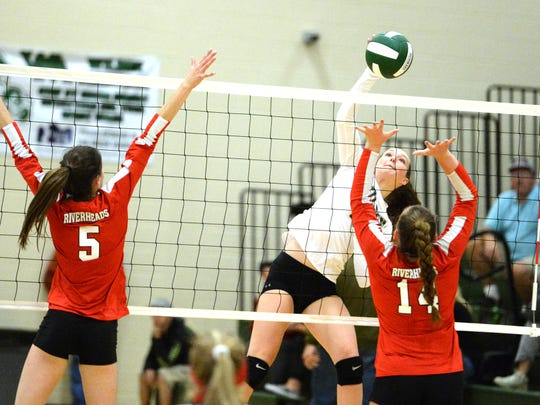 Wilson Memorial's Cassidy Davis goes up for an attack Thursday in a match against Riverheads. Defending the shot are Riverheads' Abbey Eavers (5) and Dayton Moore (14).