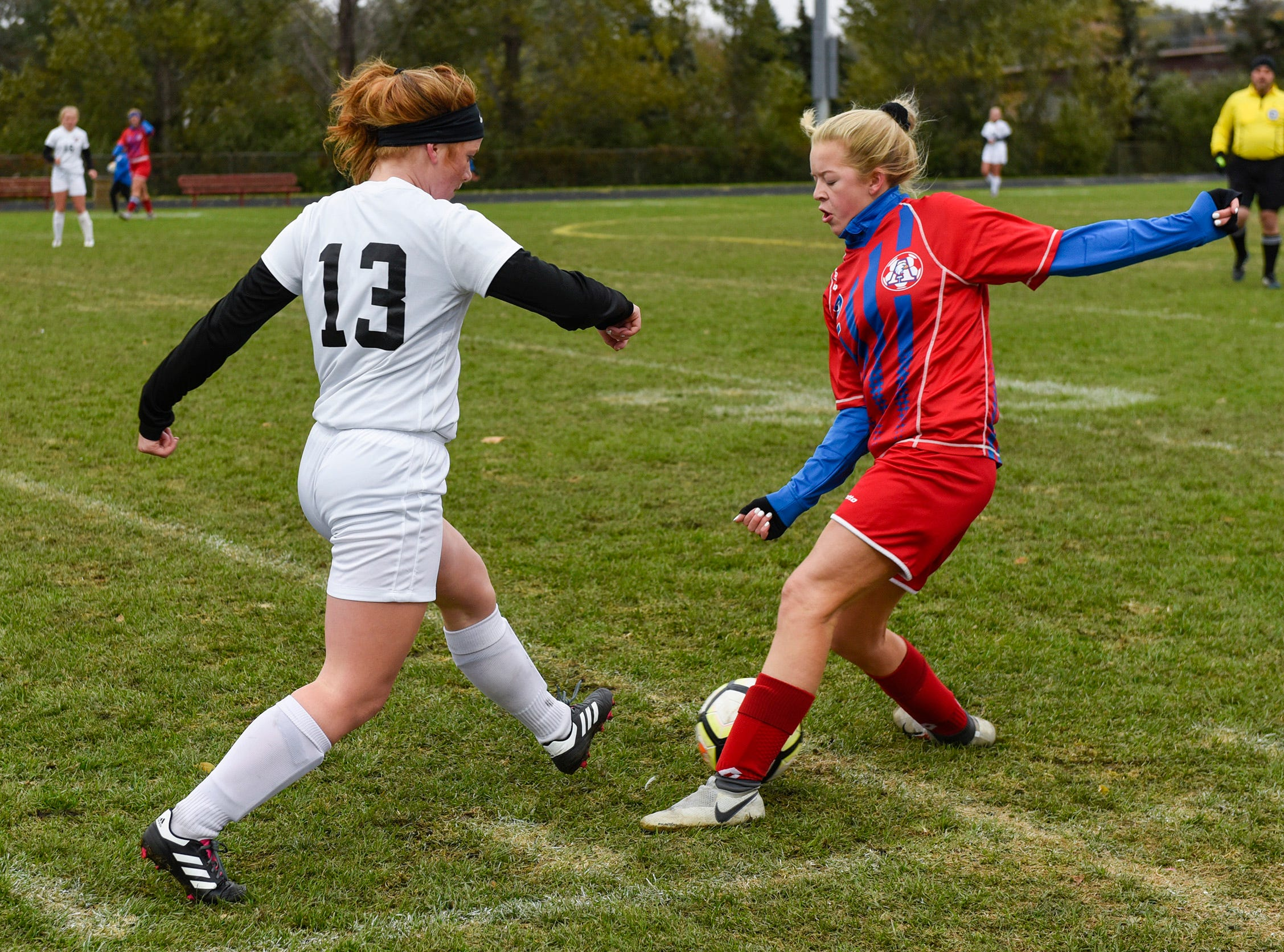 ROCORI's Bree Griffin tries to pass past Apollo's Sofie Streich during the first half Thursday, Oct. 11, at Apollo High School.